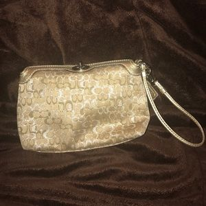 Coach Gold Pearlescent wristlet